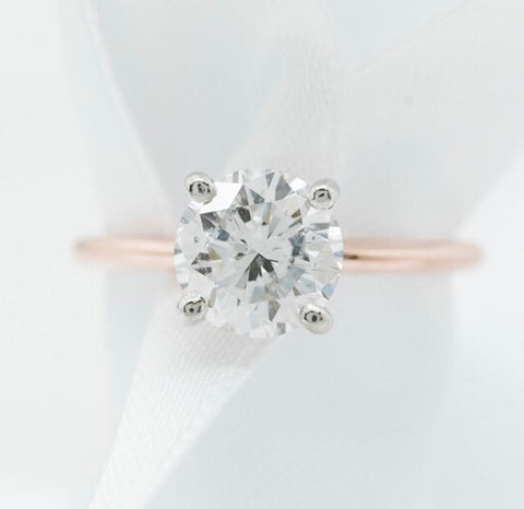 solitaire diamond engagement ring with a thin and delicate rose gold band