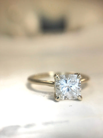 Custom cushion cut diamond engagement ring with a gold band