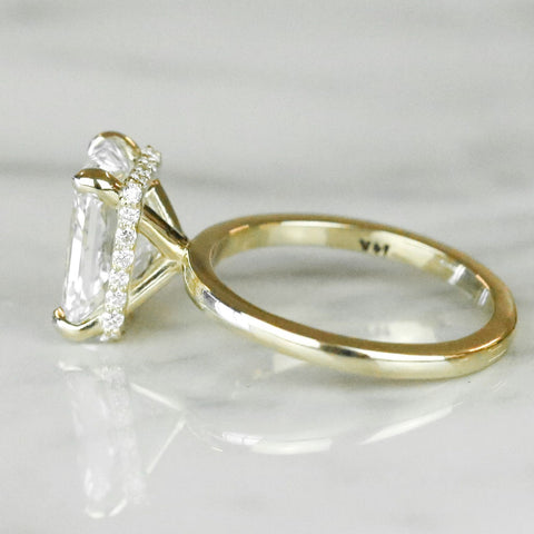 radiant cut diamond engagement ring with a hidden halo