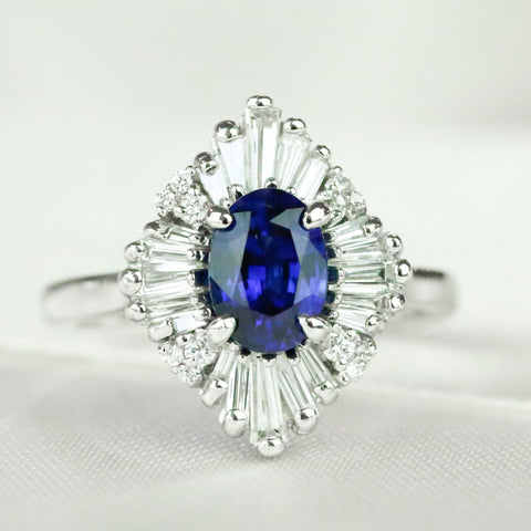 Blue oval sapphire engagement ring with a baguette and round diamond unique halo