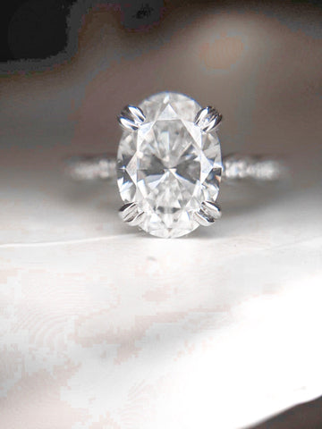 Custom oval cut white gold diamond engagement ring with double claw prongs