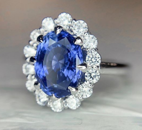 Custom sapphire engagement ring with a delicate halo