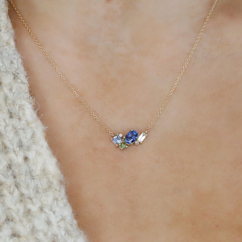 14k yellow gold light blue oval sapphire and diamond cluster necklace with 16in chain