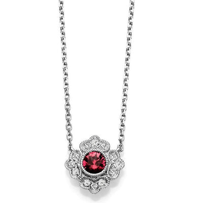 14k whie gold ruby bezel set necklace with milgrain details and an intricate diamond halo