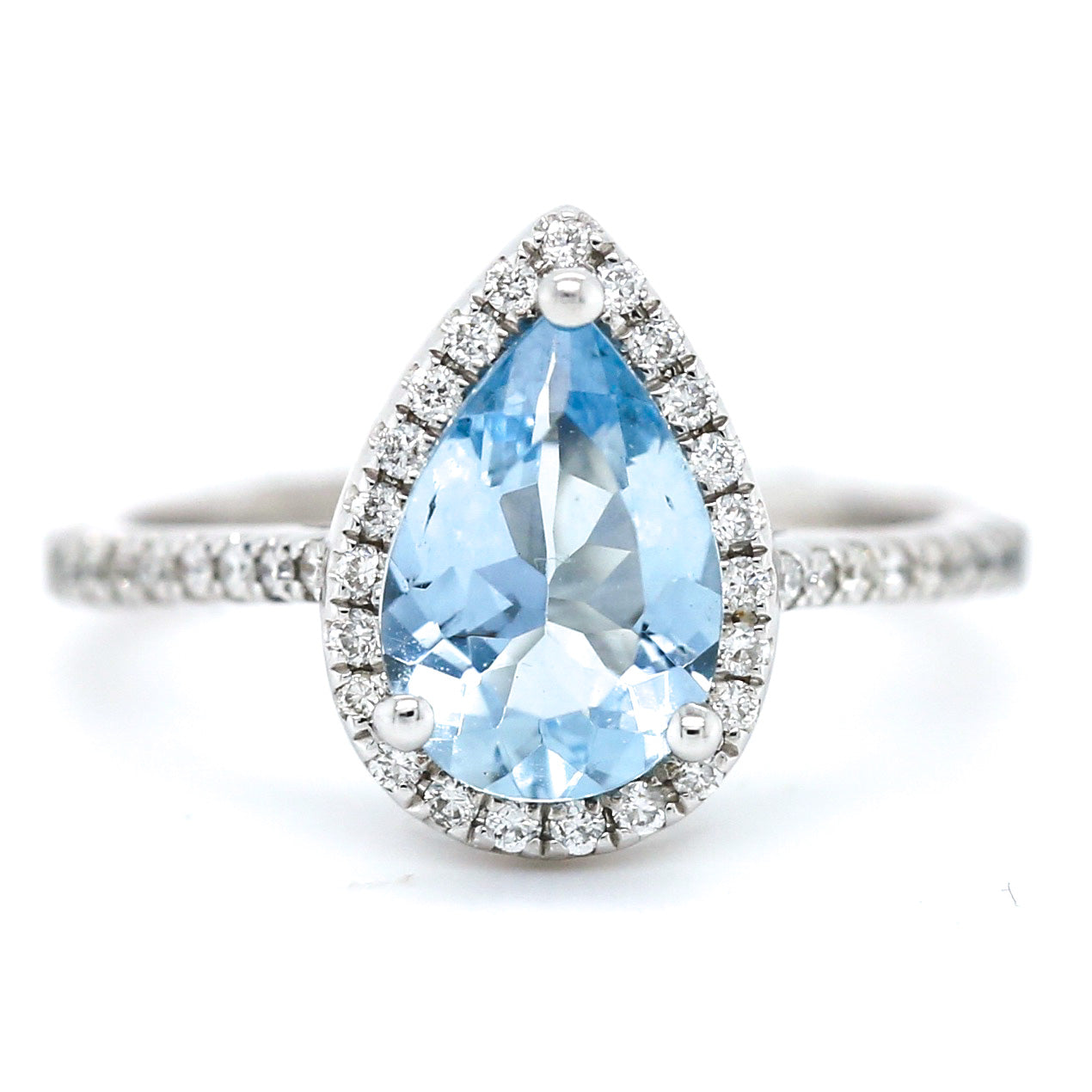14k white gold aquamarine pear shaped estate ring with diamonds on the band and a matching diamond halo
