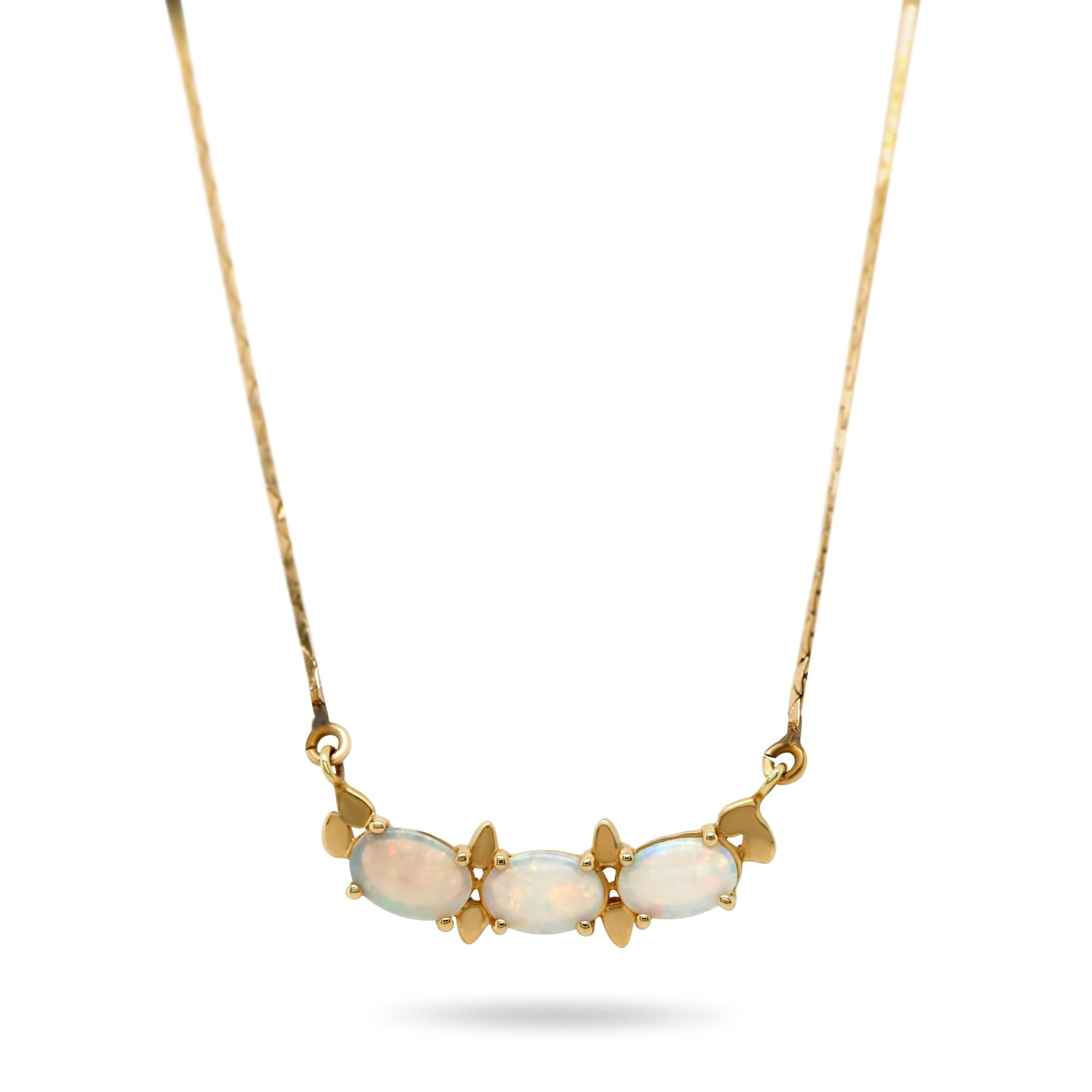 yellow gold three stone oval opal estate necklace with metal details and a 16in chain under 500