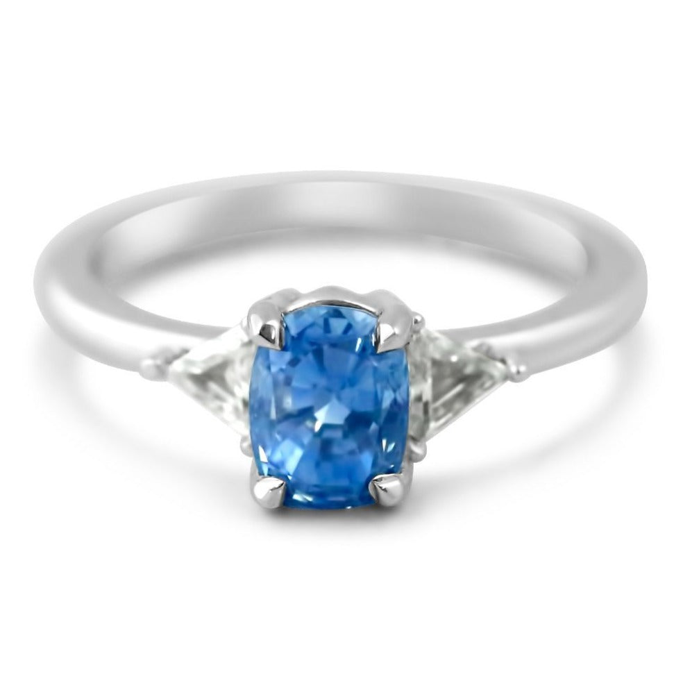 14k white gold three stone light blue sapphire oval ring with triangular side stones