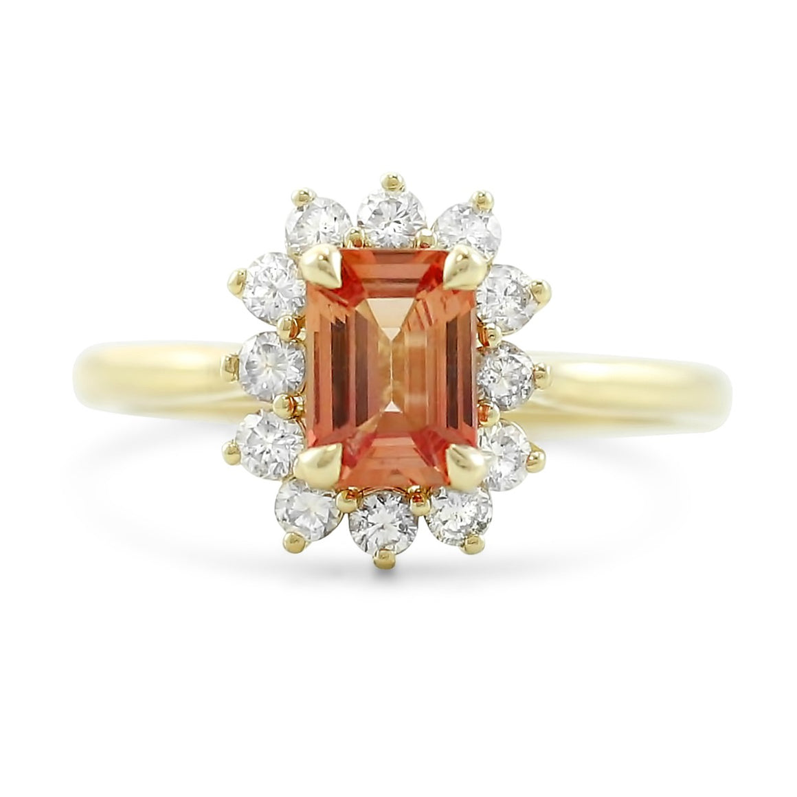 Red emerald cut sapphire ready to ship engagement ring with a diamond halo and 14k yellow gold band