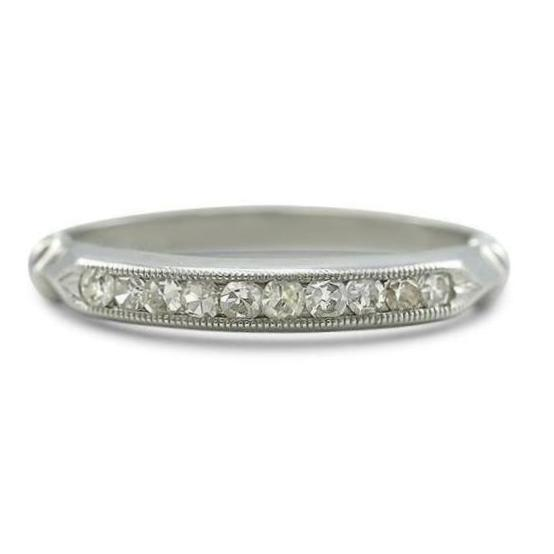 Ten single cut diamonds on a platinum estate wedding band with milgrain