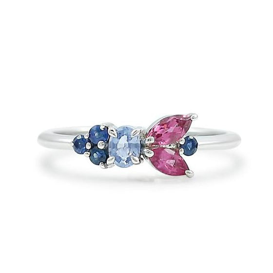 ethically sourced pink tourmaline and recycled blue sapphire gemstone cluster ring with a white gold band
