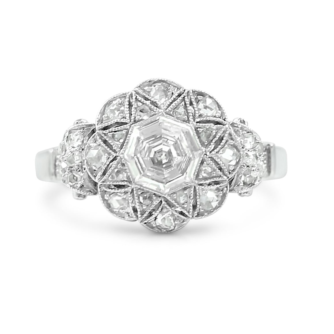 platinum octagon shaped antique engagement ring with milgrain details and a flower pattern of diamonds created circa 1930