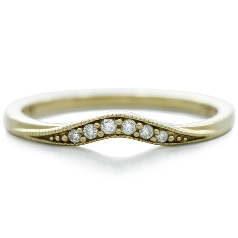 Yellow gold and white diamond estate wedding band with a slight contour
