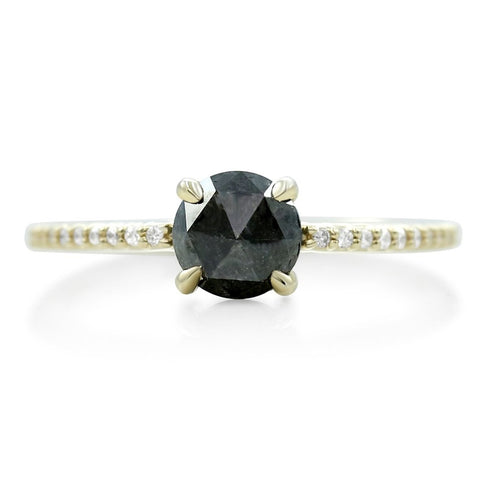 rose cut black diamond ring with white diamonds and a thin yellow gold band
