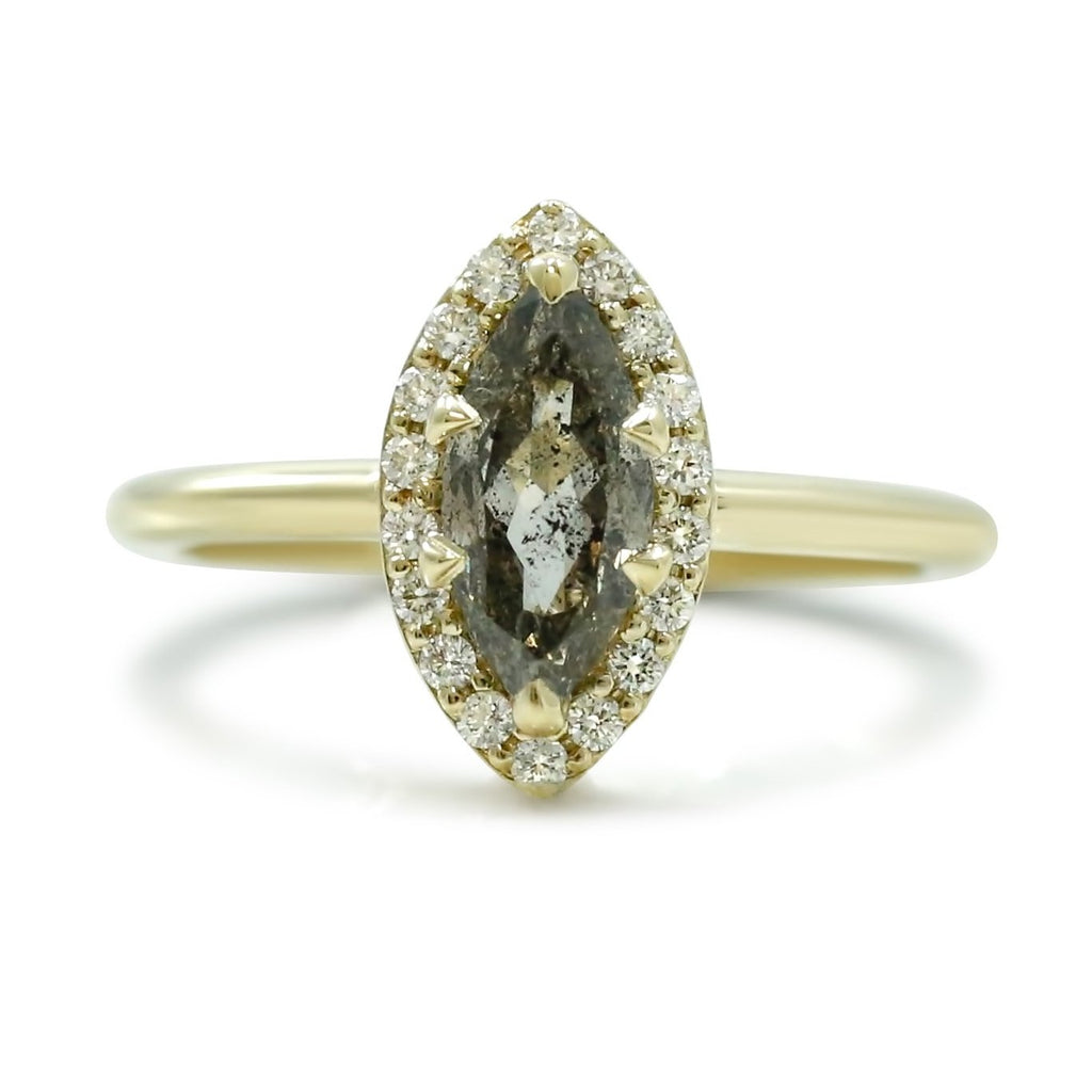 marquis shaped brown diamond engagement ring with a white diamond halo and thin yellow gold band