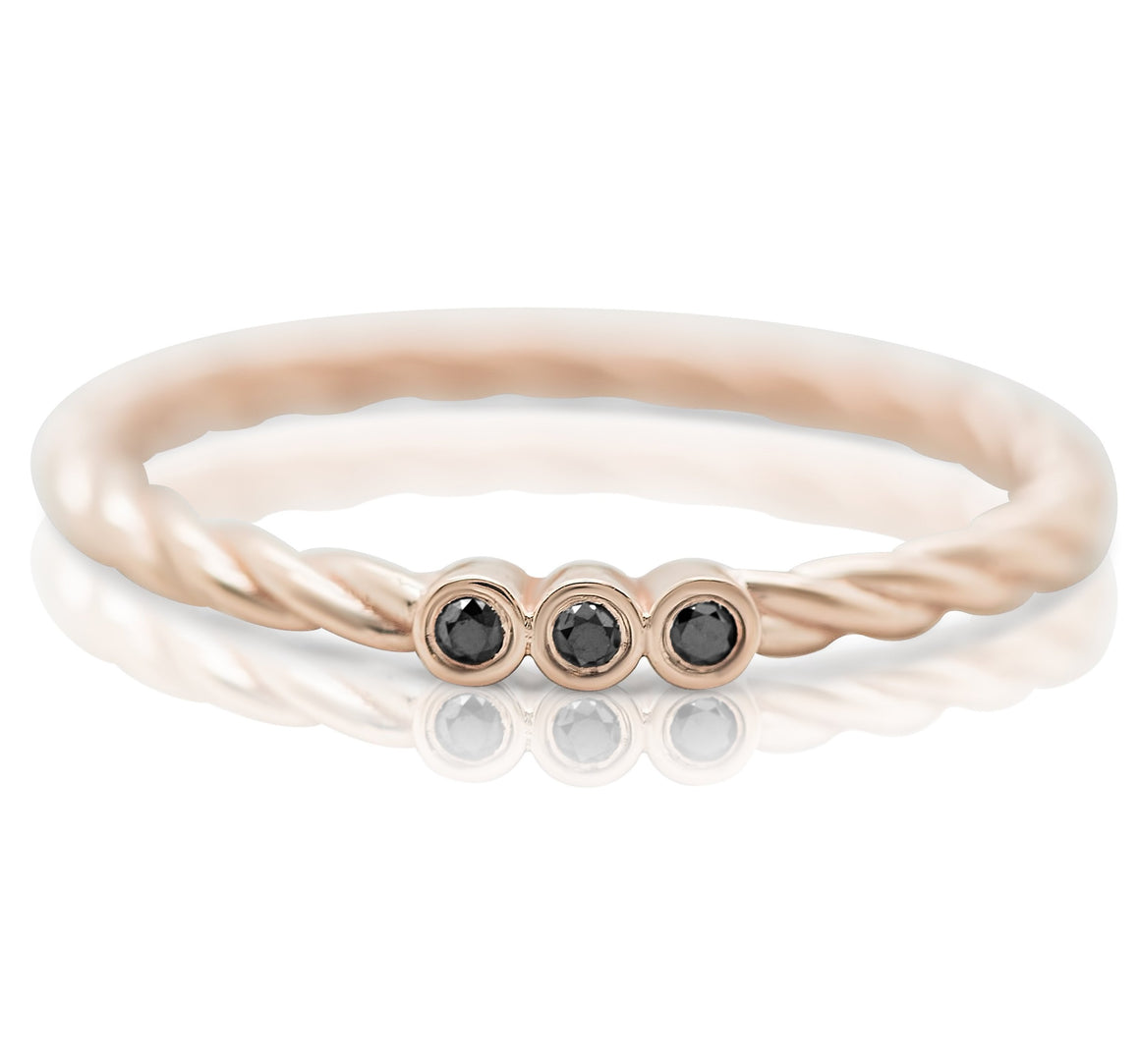 Rose gold braided band and black diamond stack ring