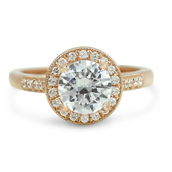 ready to ship diamond engagement ring with a matching milgrain diamond halo, diamonds on the band and filigree details. various shapes and metals available