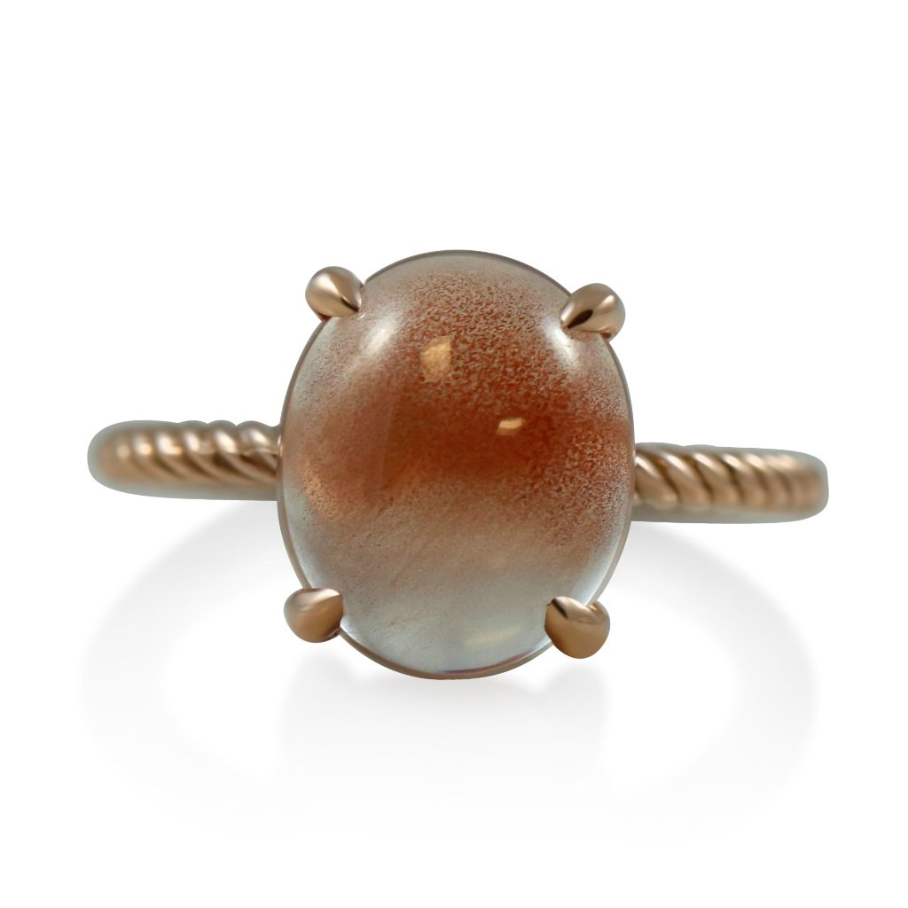 sunstone and rose gold right hand ring with claw prongs and a braided band