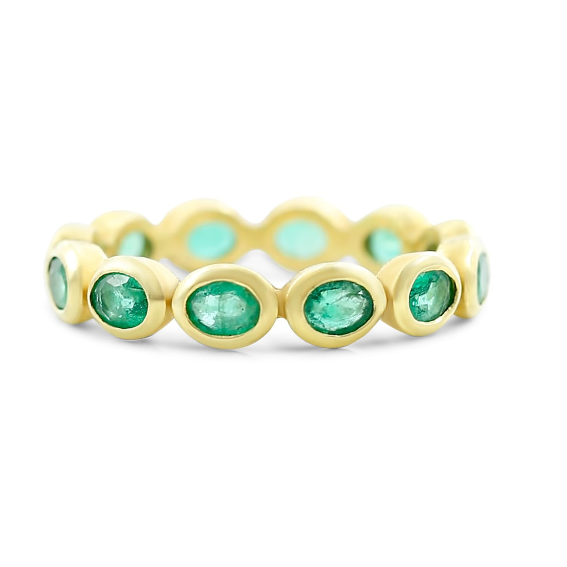 emerald gemstone eternity band bezel set in 18k yellow gold