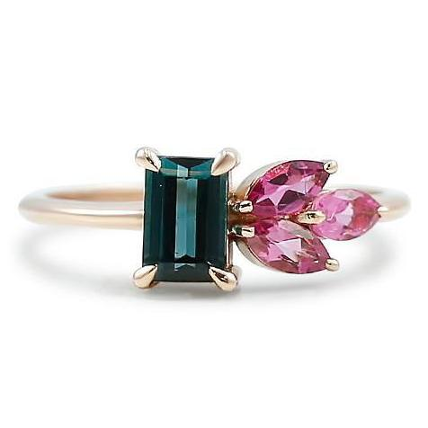 pink and green tourmaline gemstone cluster ring with claw prongs and a rose gold band