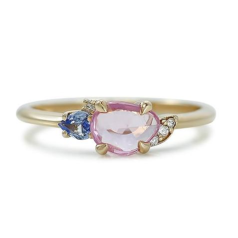 pink and blue sapphire ring with a white diamond and yellow gold leaf details