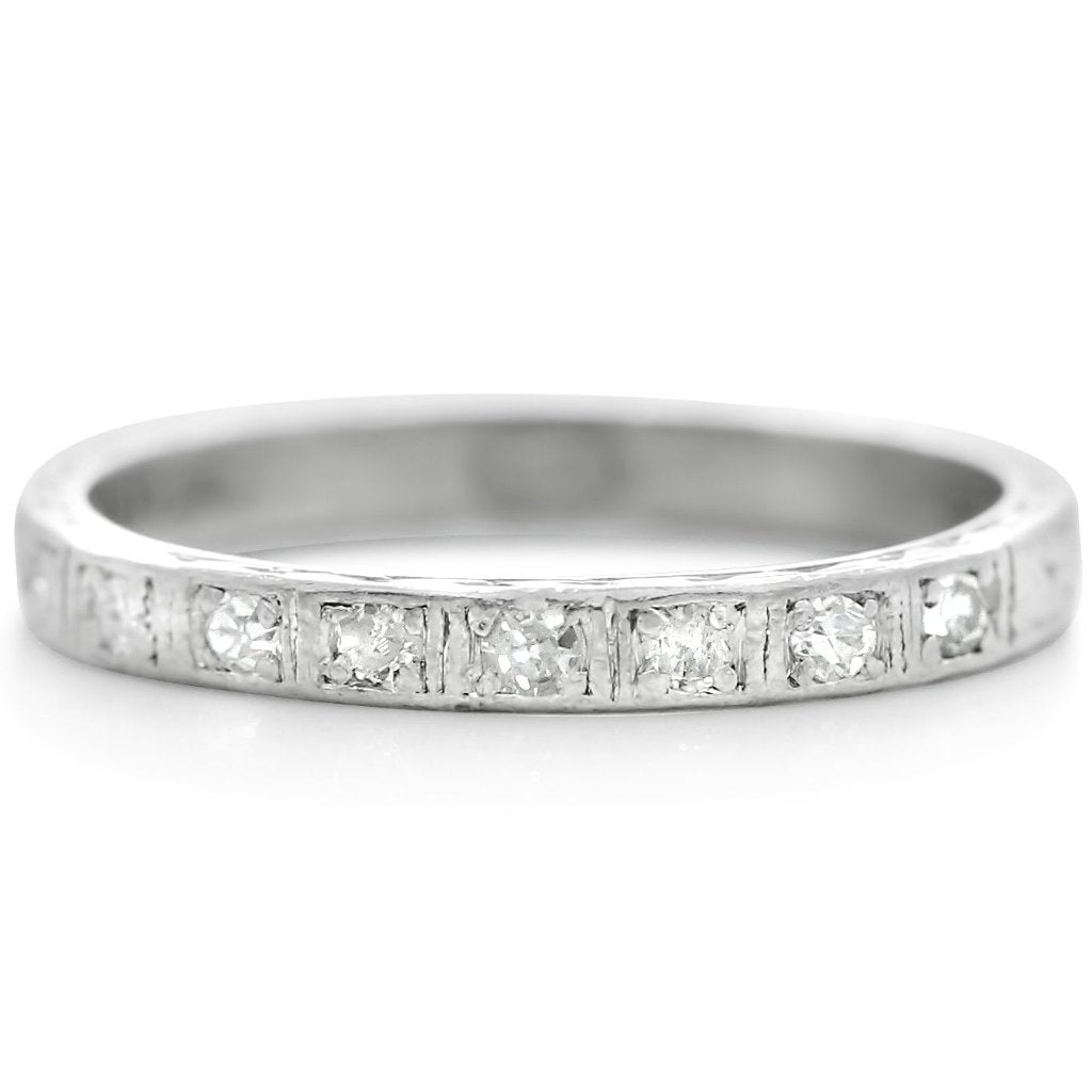 platinum estate wedding band from the 1920s with seven single cut diamonds and hand engraving