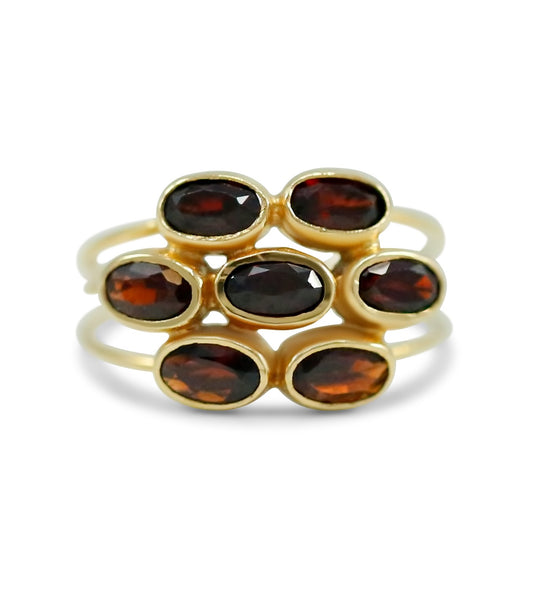 bezel set oval garnet triple band flower estate ring