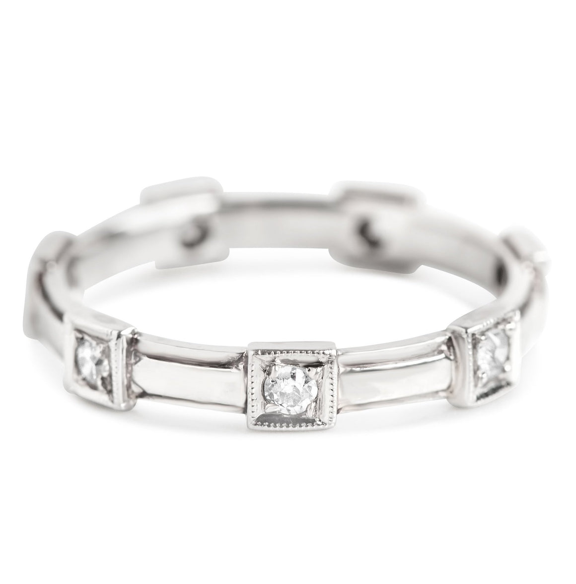 ESTATE WEDDING BAND WITH SEVEN SINGLE CUT DIAMONDS AND WHITE GOLD