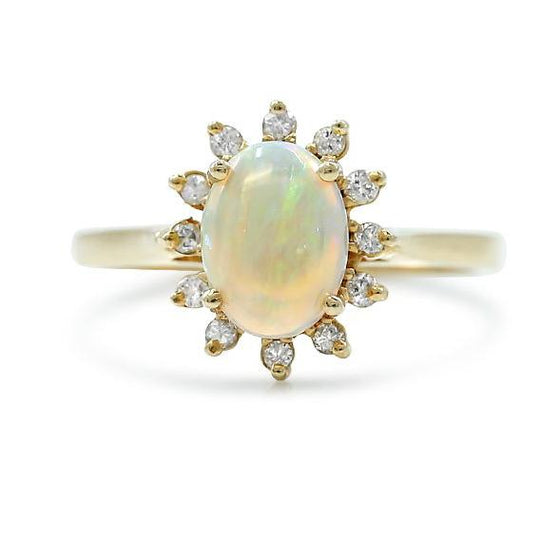 14k yellow gold and opal estate ring with a diamond halo