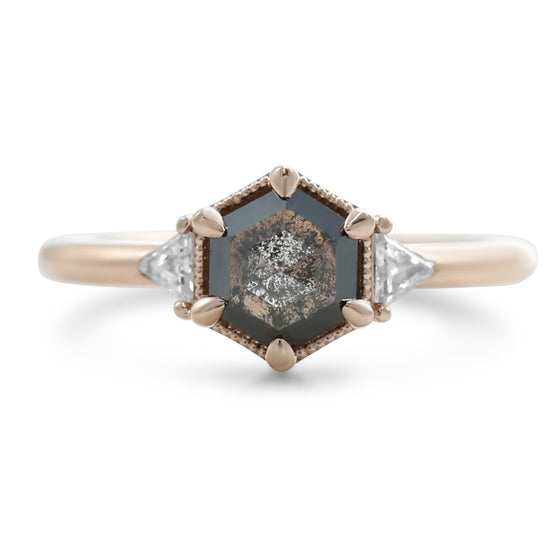 geometric inspired hexagon shaped rose cut gray diamond ring with triangular white diamonds on both sides and a 14k rose gold band