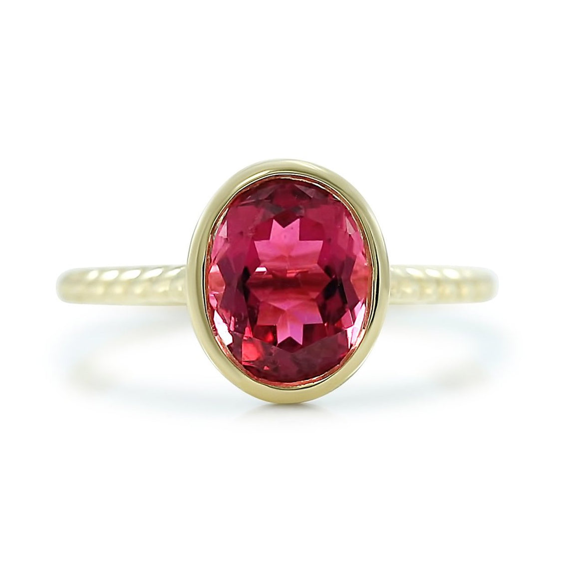 14k yellow gold bezel set oval pink tourmaline ring with a braided band