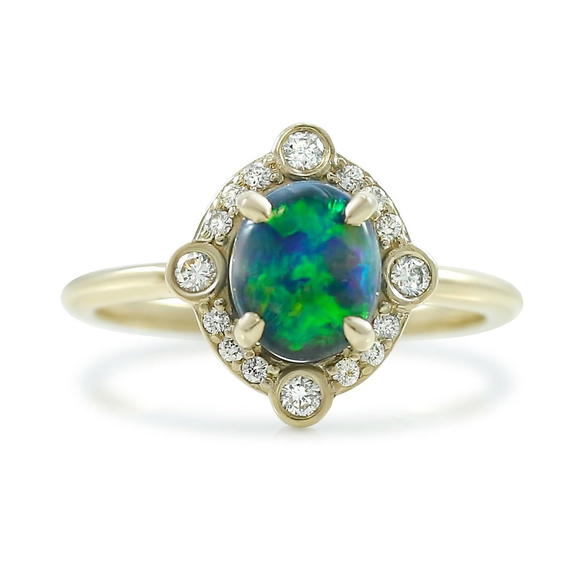 14k yellow gold black opal ring with a diamond halo prong set with a thin simple band