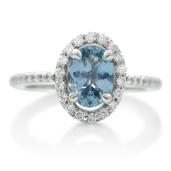 oval montana no heat sapphire ring with a diamond halo and white gold band