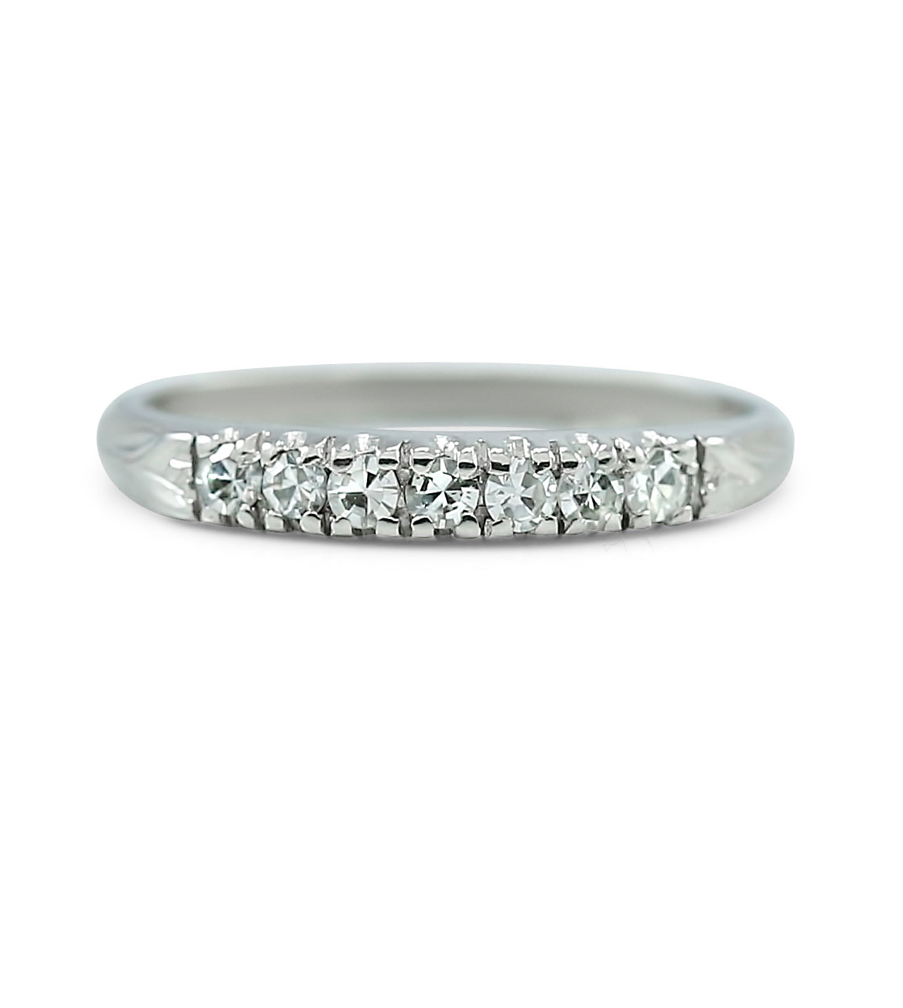 Platinum estate wedding band with ~0.25tcw diamonds and an engraved pattern on the band
