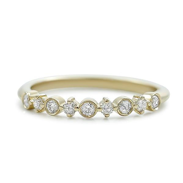 diamond wedding band with prong and bezel set diamonds available in white rose or yellow gold