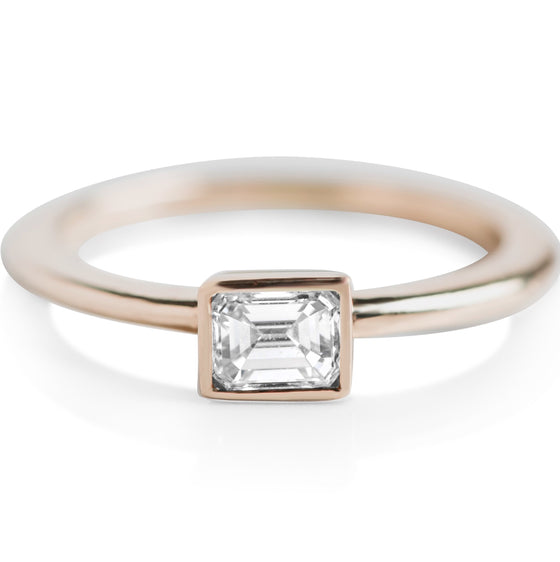 yellow gold engagement ring with emerald cut baguette diamond