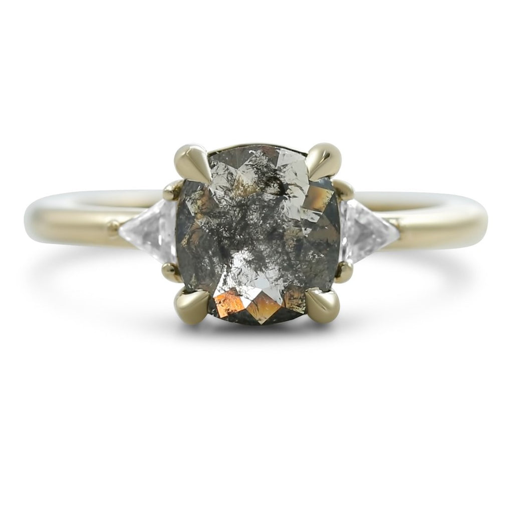 cushion and rose cut gray diamond ring with white triangular diamonds on both sides set with claw prongs in 14k yellow gold