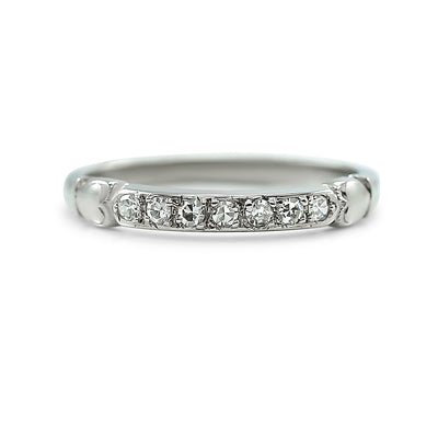14k white gold 0.11tcw diamond estate wedding band with heart details
