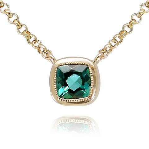 bezel set green tourmaline gemstone necklace with a yellow gold chain