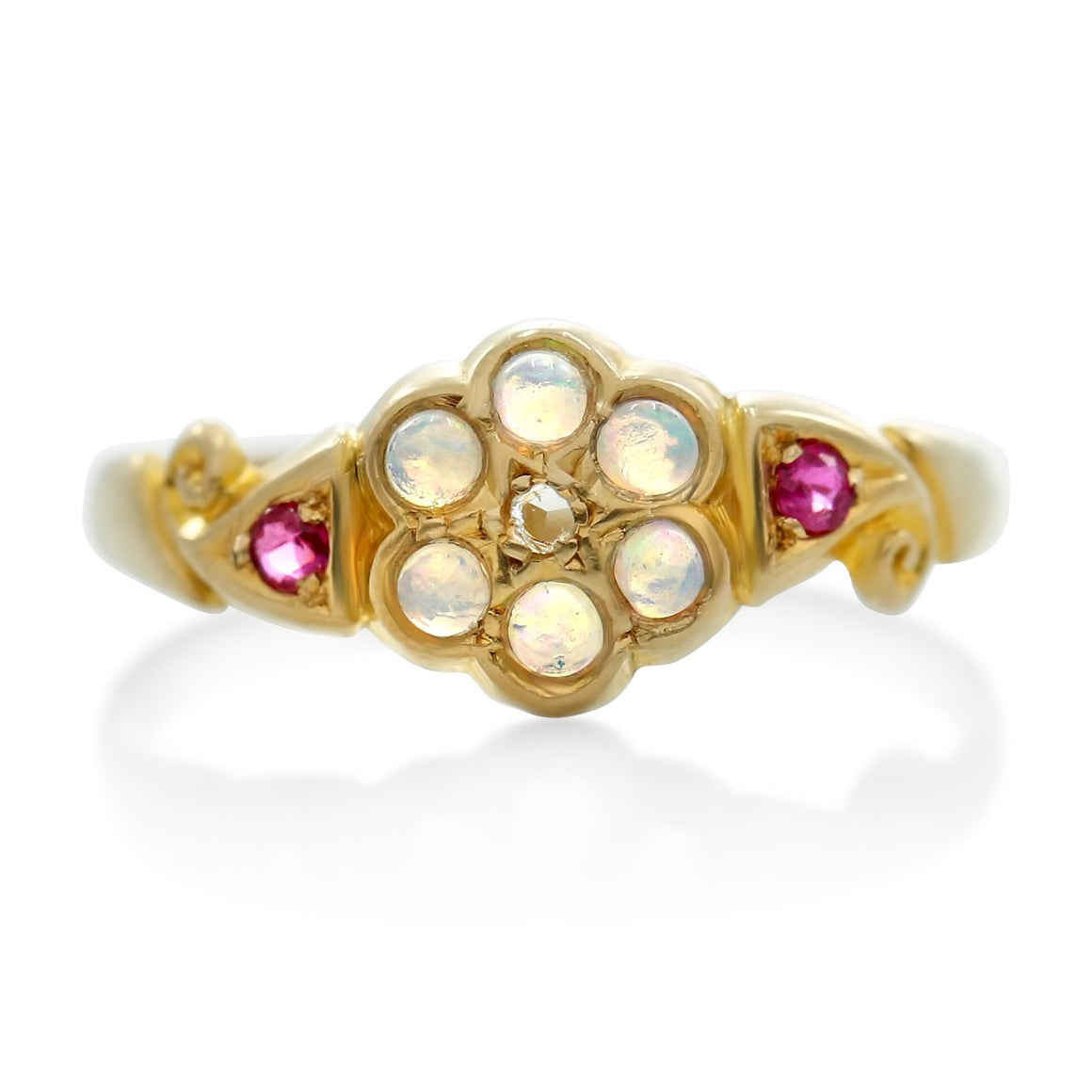 opal and ruby gemstone victorian flower ring with a rose cut diamond and yellow gold band