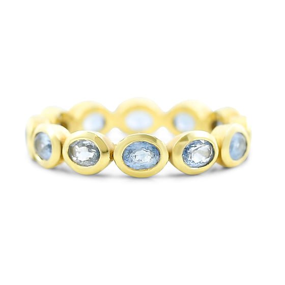 blue/purple pastel sapphire eternity band bezel set in 18k yellow gold