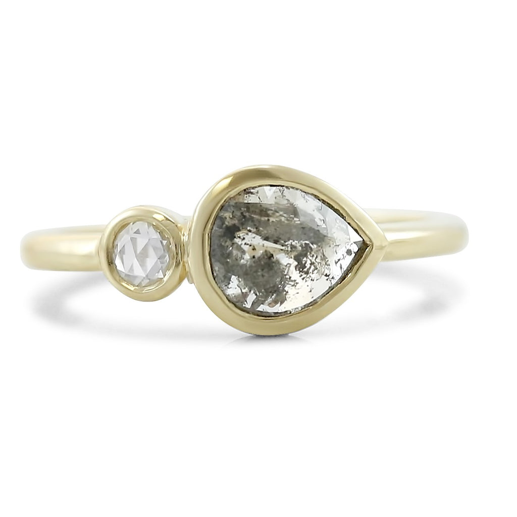 bezel set rose cut gray salt and pepper pear shaped diamond ring set east west with a round white rose cut diamond in 14k yellow gold