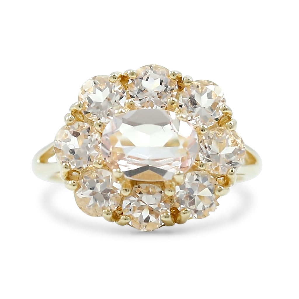 morganite flower shaped estate ring with yellow gold split shank band