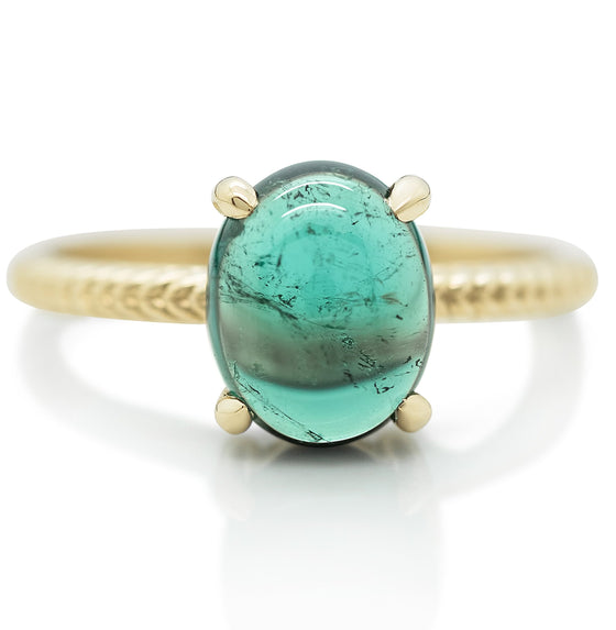 Emerald gemstone right hand ring with a yellow gold band