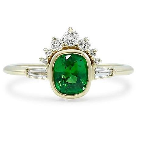 bezel set green tsavorite garnet center stone ring with diamond halo and baguette side stones