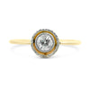 18k yellow and white gold bezel set diamond antique engagement ring with a milgrain halo and engraved details