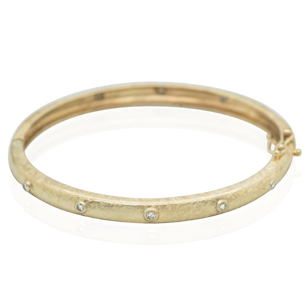 14 KARAT GOLD HAND MADE ESTATE BRACELET WITH EIGHT DIAMONDS AROUND BANGLE