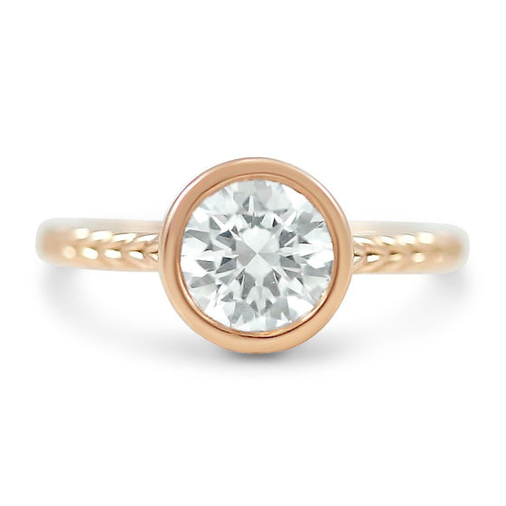 bezel set round diamond engagement ring ready to ship with a braided band available in yellow, rose or white gold