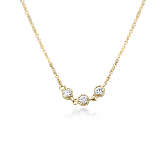 bezel set three stone diamond necklace with round brilliant cut diamonds and a yellow gold chain