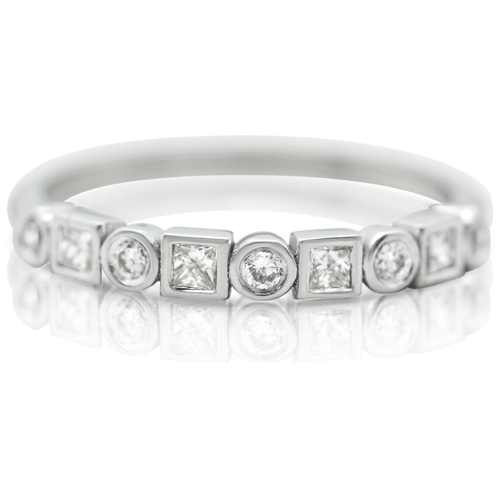 SQUARE AND CIRCLE DIAMONDS WITH A WHITE GOLD BAND