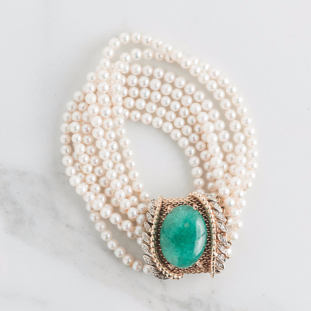 pearl bracelet with green gemstone